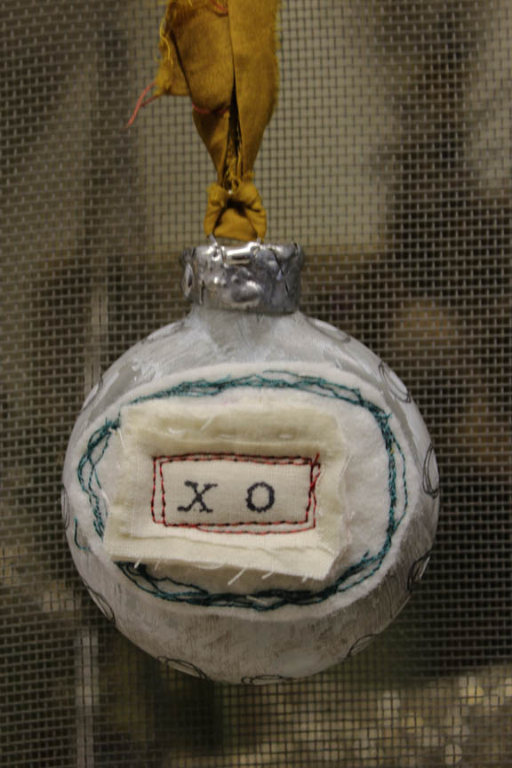X O glass ornament